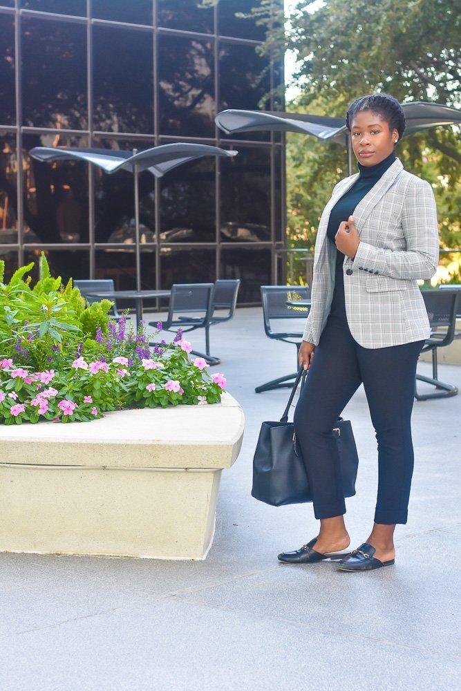 Jazzmine standing outdoors holding black handbag