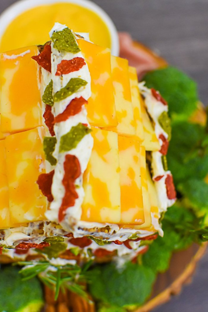 crushed red and green tortilla chips mimic Christmas lights on top of charcuterie chalet