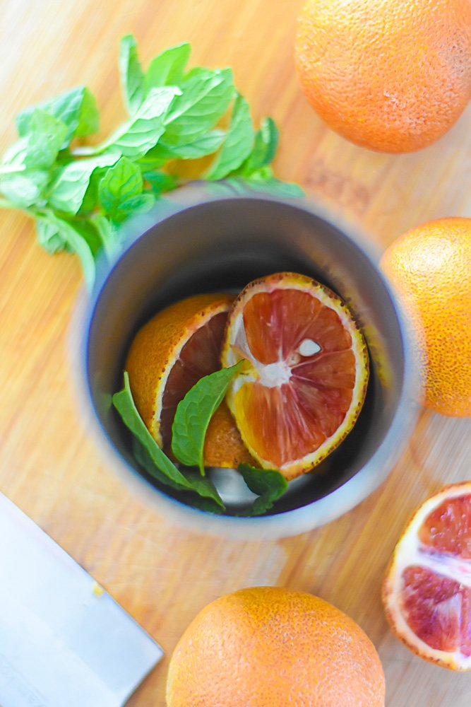 blood orange segments and mint leaves in cocktail shaker