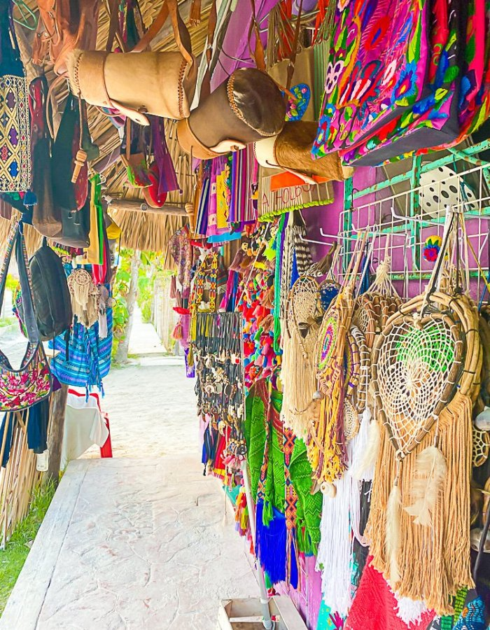 colorful hanging bags, weavings, and other crafts in souvenir shop