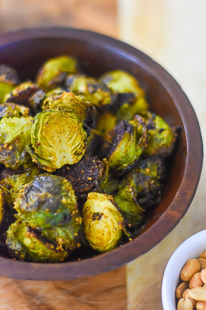 crispy roasted brussels sprouts seasoned with suya spice blend.