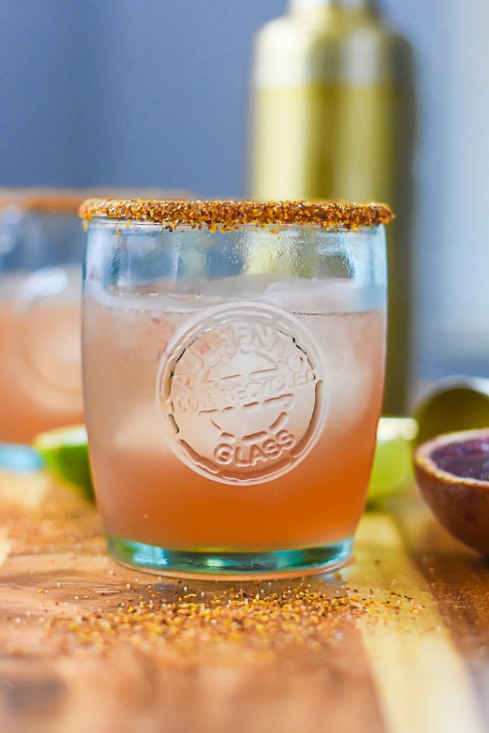 blood orange mezcal margarita in recycled glass cup.