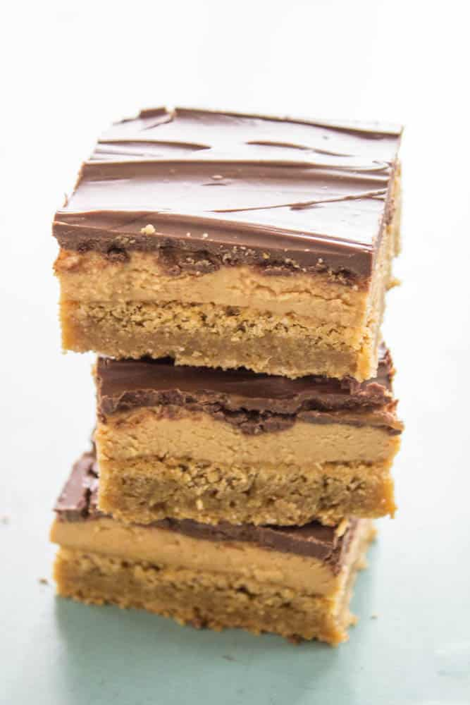 Tagalong Blondies are better than the original Girl Scout Cookies! Creamy peanut butter over a buttery Blondie, finished off with chocolate.