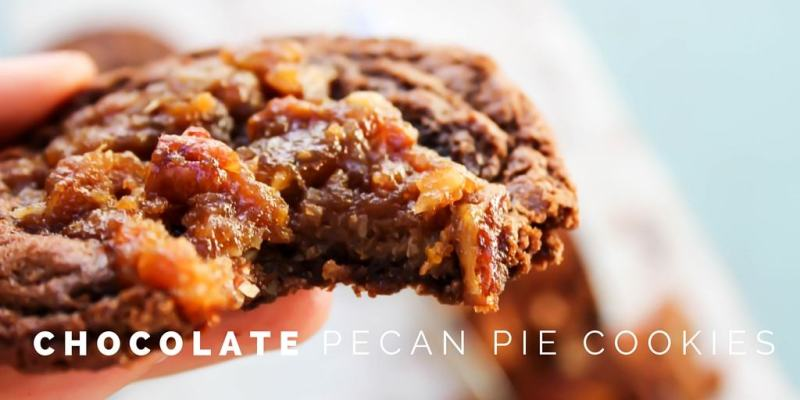 These Chocolate Pecan Pie Cookies are a delicious soft and chewy chocolate cookie with a classic pecan pie filling baked into the center.