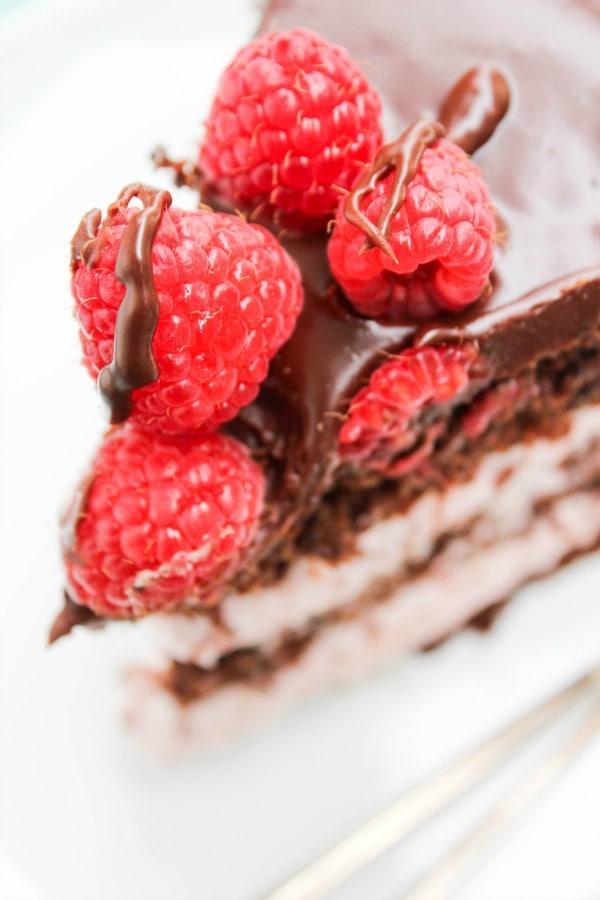 CHOCOLATE RASPBERRY LAYER CAKE, raspberries, chocolate cake, spoons, white plate