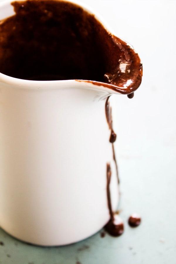 COOKIES & CREAM HOT FUDGE SAUCE - Chocolate sauce in porcelain saucer