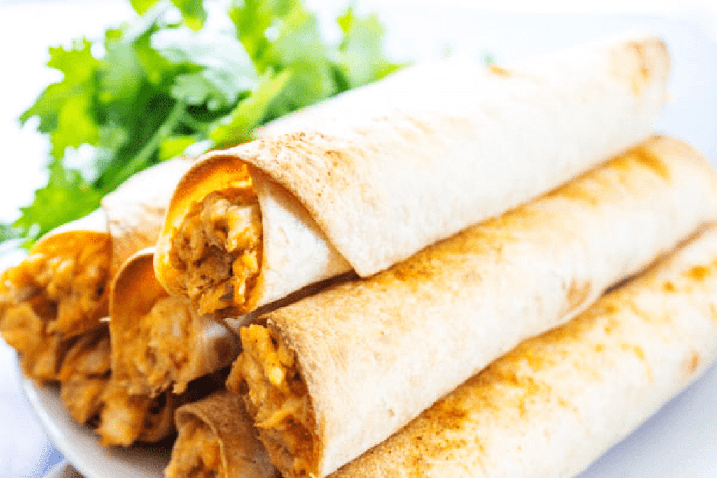 BAKED TACO RANCH TAQUITOS - Filled with a cheesy taco ranch chicken and then baked to perfection,they are perfect for any game day or holiday get together.