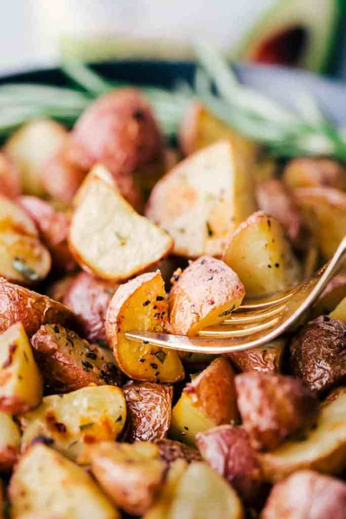 roasted potatoes on a fork
