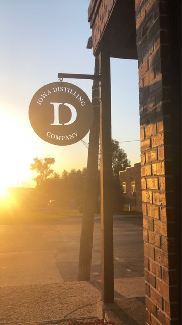 picture of iowa distilling sign at sunset