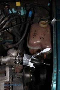 Rover Mini Xn -fixierter Kühlschlauch