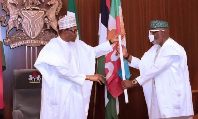 Buhari presents APC Flag to Rotimi Akeredolu