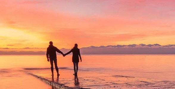 Photo of a couple walking in Victoria, BC