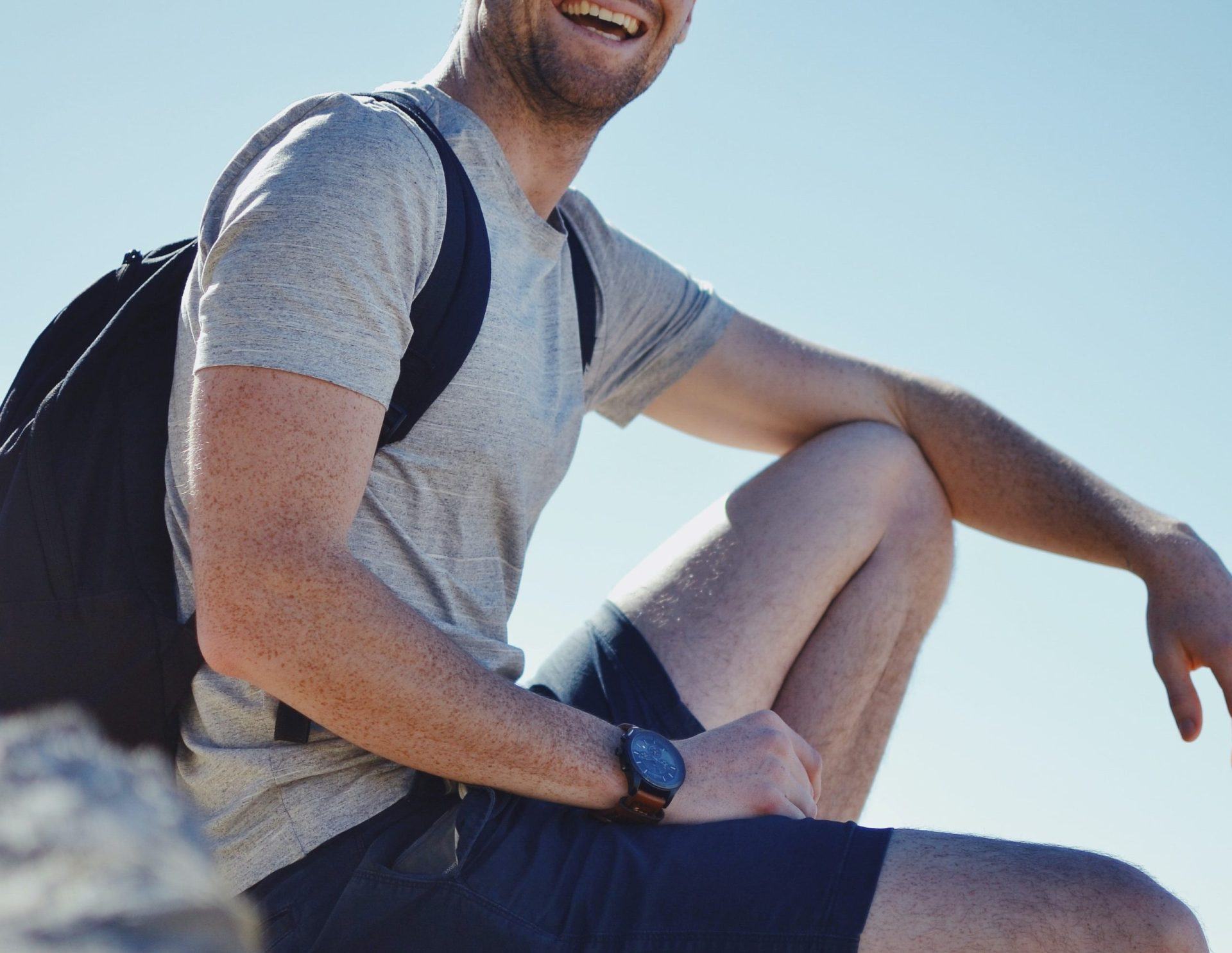 Man smiling while on a hike