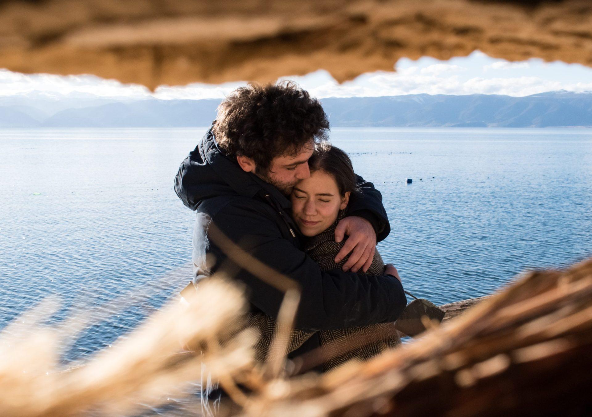 Man Hugging woman in comfort
