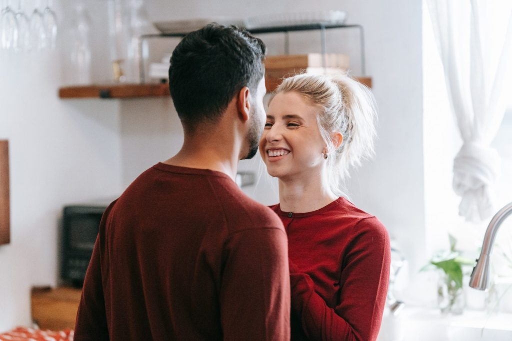 Couple smiling and talking to one another