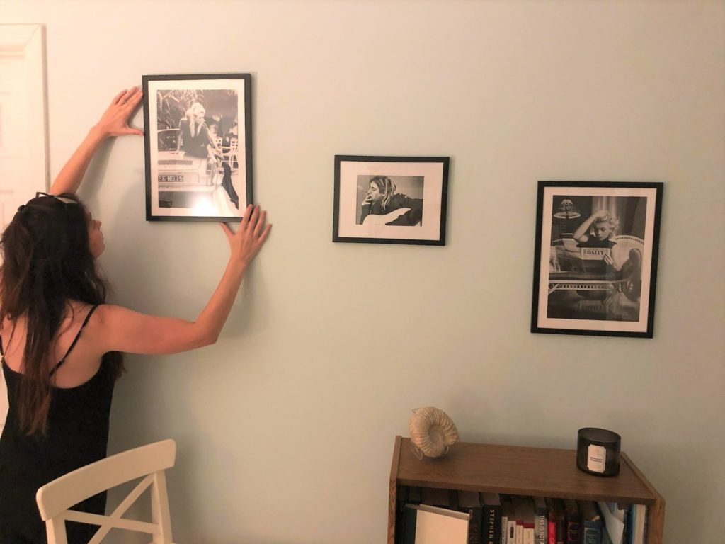 Hanging Prints from Posterstore over bookshelf