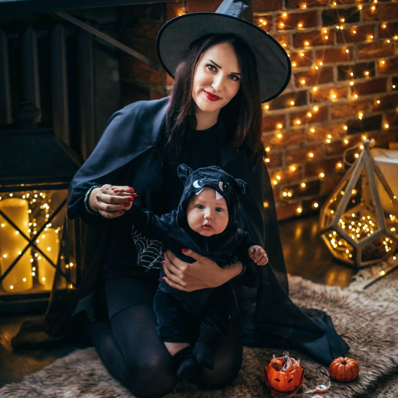 Witch costume with baby as cat (or bat)