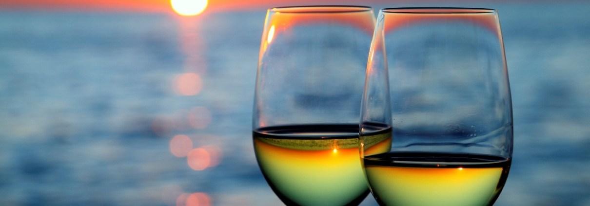 Wine glasses on beach