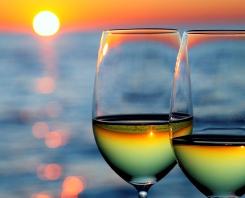 Wine glasses on beach