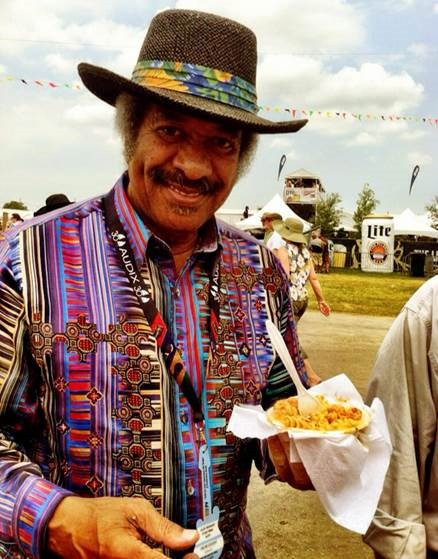 Allen Toussaint enjoying some food.