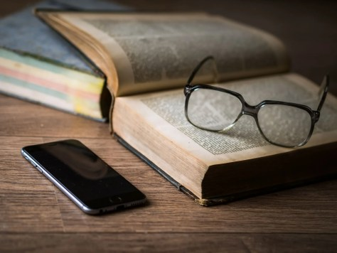 Photo of Book, Glasses, and Phone