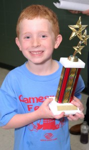 This little guy seemed to enjoy his recycled trophy earned at the boys and girls clubs in Springfield.