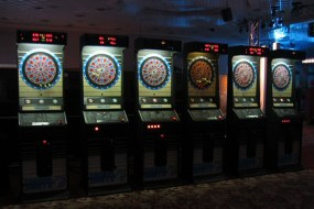 Redemption Games and Dart Boards