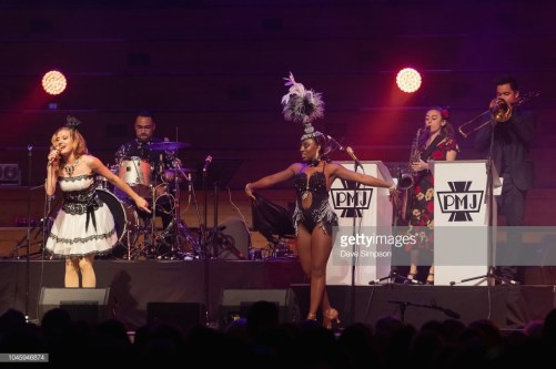 AUCKLAND, NEW ZEALAND - OCTOBER 05: Ariana Savalas and Anissa Lee of the American band Scott Bradlee's Postmodern Jukebox perform on stage at Auckland Town Hall on October 5, 2018 in Auckland, New Zealand. (Photo by Dave Simpson/WireImage)