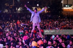 AUCKLAND, NEW ZEALAND - OCTOBER 21: A man is lifted up in crowd during the 17th Auckland Diwali Festival on October 21, 2018 in Auckland, New Zealand. Auckland Diwali Festival is one of Auckland's biggest and most colourful cultural festival, celebrating traditional and contemporary Indian culture. (Photo by Dave Simpson/WireImage)