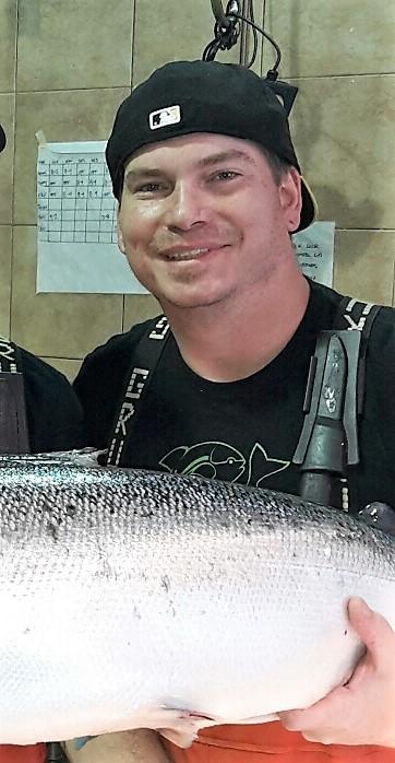 Fishmonger Tim Reynolds holding a fresh Faroe Island salmon.