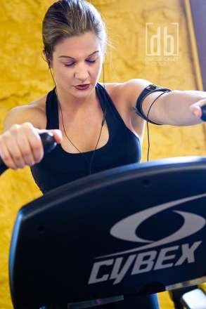 Diana Chaloux on a Cybex Arc Trainer photographed by David Bickley Photography