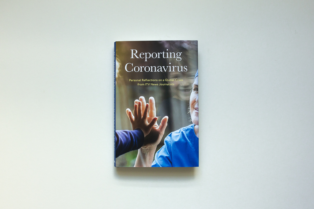 Photo of a copies of the book 'Reporting Coronavirus', from above showing the front cover