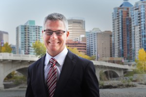 David Cory stands with the Calgary City skyline in the background