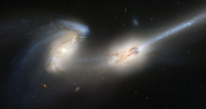 The Mice, two merging galaxies with tidal tails.  Hubble Space Telescope.
