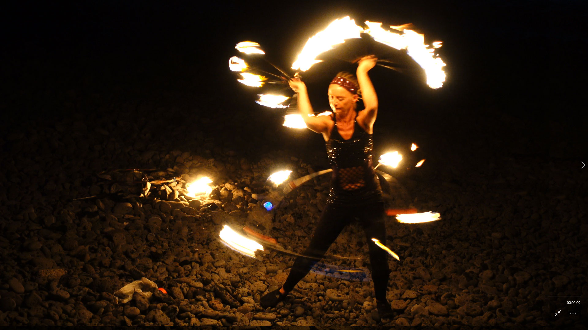 Fire dancing girl on a Canary Island beach