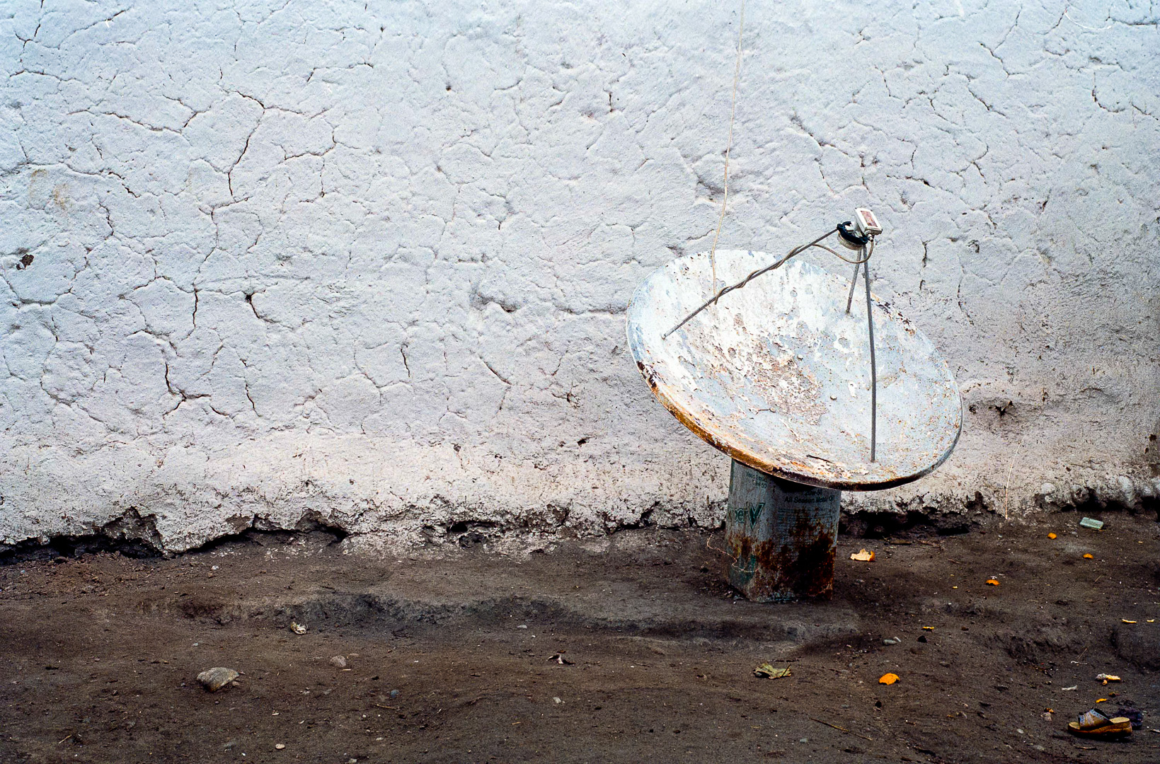 Satellite dish outside a house in the village of Catal Köy, near Diyarbakir. The men were forced to be village guards (kidnapping of a villager, who was then released), then quit.