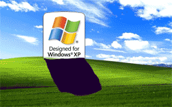 Windows XP logo as a gravestone against Windows XP desktop background