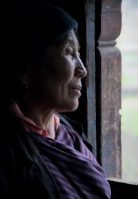 Bhutan woman by window
