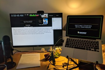 Ready for an online training with a laptop, monitor, microphone, and webcam