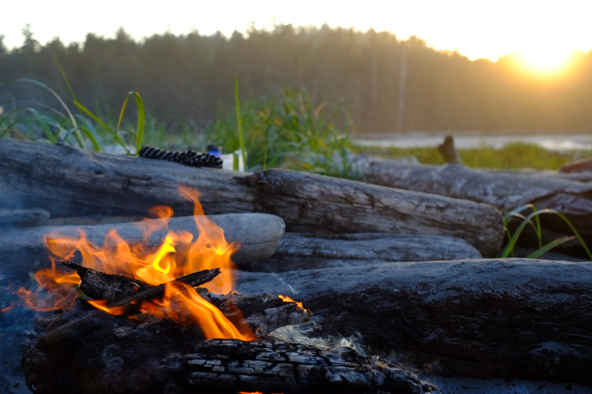 Fires burns at the campsite on Nels Bight.
