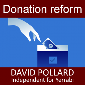 Donation reform - Hand putting money in to a ballot box