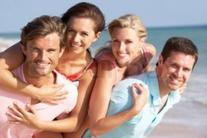 """Group Of Friends Enjoying Beach Holiday, stock photo"""