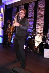 David play's saxophone on a beautifully decorated stage in Florida.