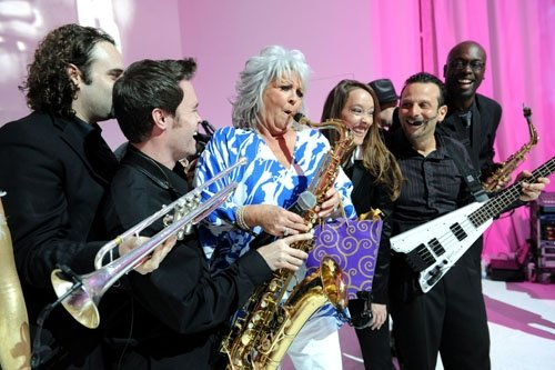 David Turner stands back as Paula Deen tries to steal his saxophone for a solo at the South Beach Wine and Food Festival!