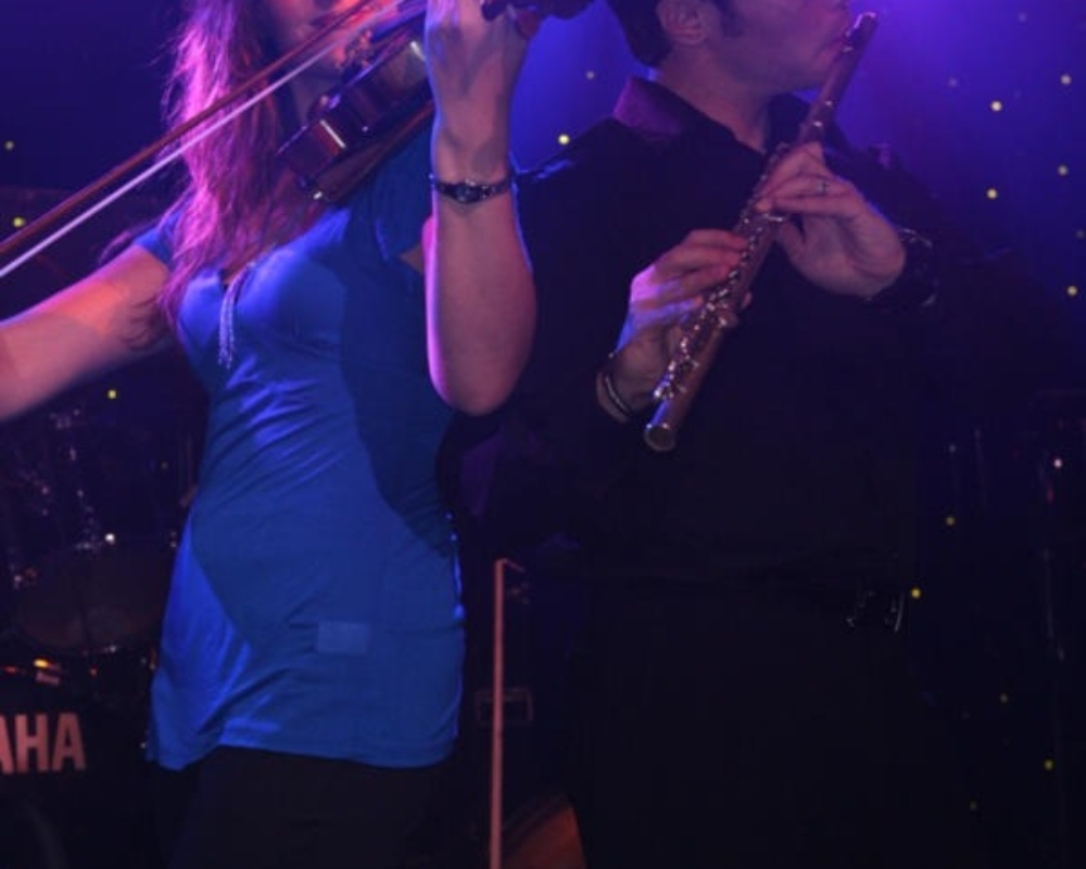 Violin and Flute Performing on Stage