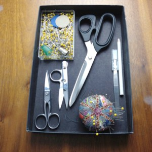 Table top sewing storage idea - use a small box lid to contain your sewing tools.