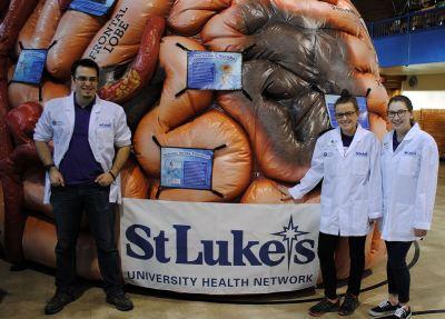 Da Vinci Science Center staff poses with the MEGA Brain.