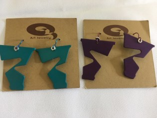 2 sets of earrings, one teal set and one purple set by Marvin Shafer