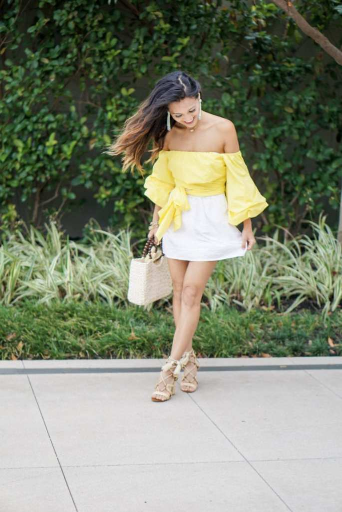 brunch outfit, white skirt, lace up heels, yellow wrap bow top, wrap blouse