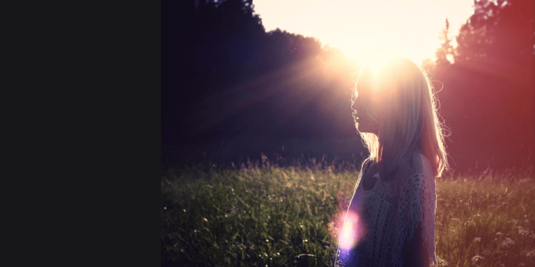 Anxiety - Woman standing in a field - breaking free from anxiety |www.dawnquest.co.uk